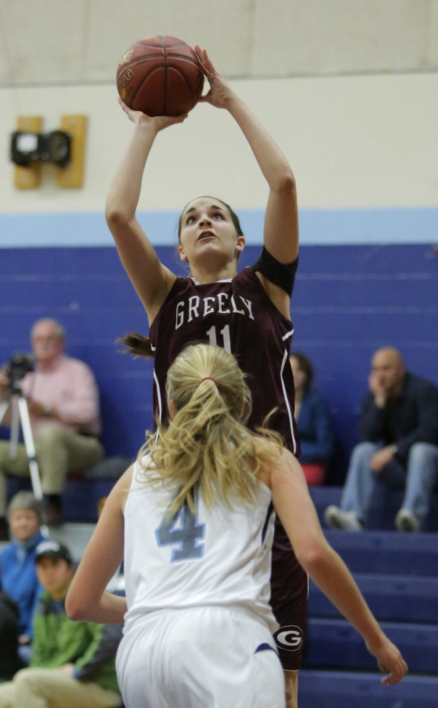 Ashley Storey of Greely puts up a shot over Shannon Todd of York during a game at York on Monday.