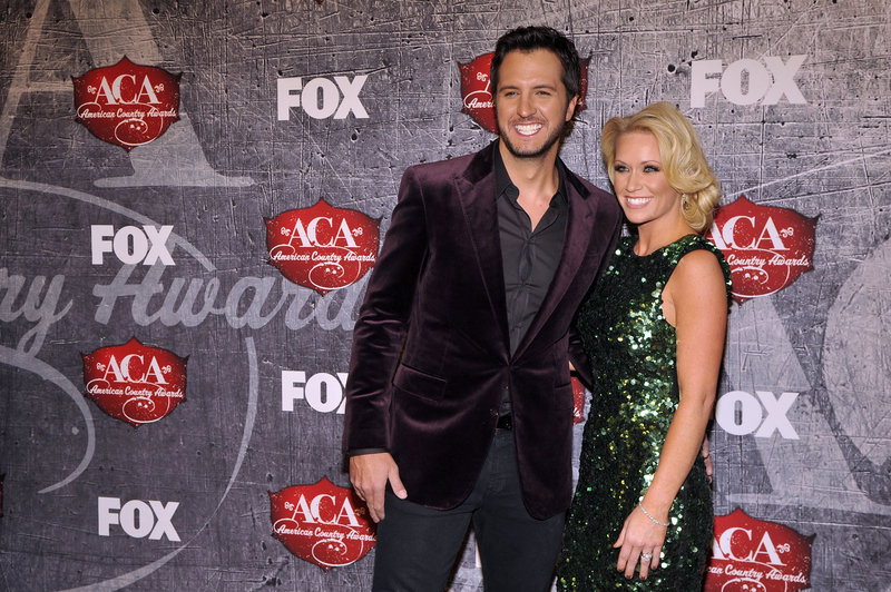 Singer Luke Bryan and Caroline Boyer arrive at the American Country Awards on Monday in Las Vegas.