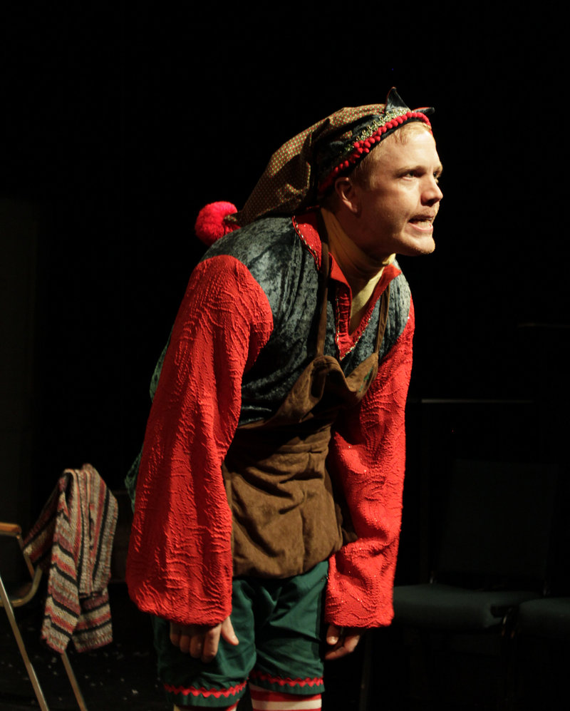 "Dustin Tucker as the disgruntled department-store elf Crumpet in ""The Santaland Diaries,"" which concludes its holiday run at Portland Stage Company on Sunday."