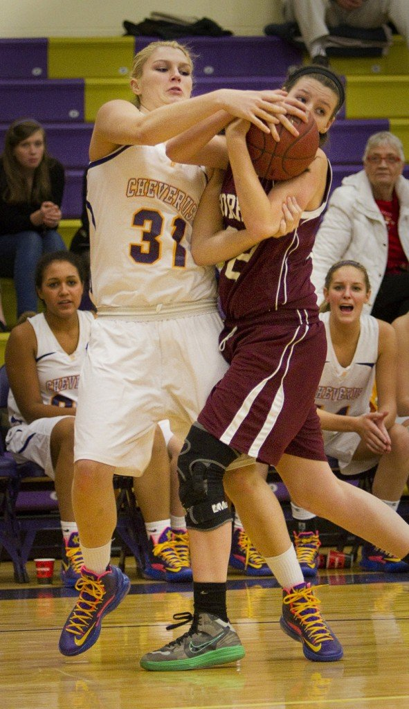 Cassidy Grover of Cheverus, left, and Molly Merrifield of Gorham compete for a loose ball Tuesday night.