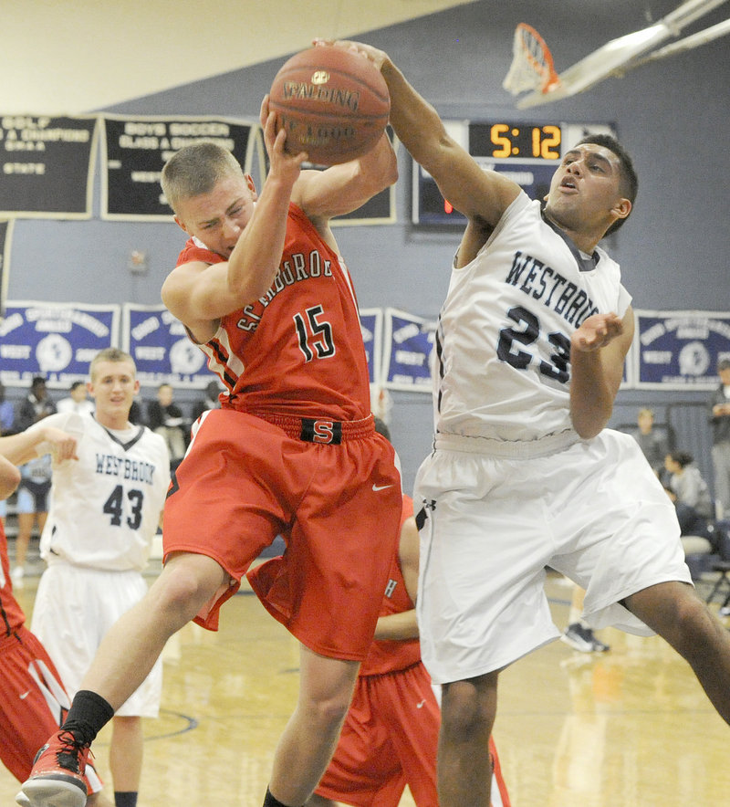 Sam Wessel of Scarborough, left, attempts to keep a rebound from Keenan Lowe of Westbrook during Westbrook's 63-59 victory Tuesday night.