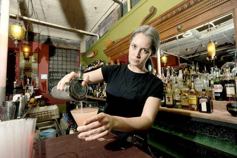 Bartender Mariah Bergeron pours a Caricature cocktail at Local 188 in Portland.