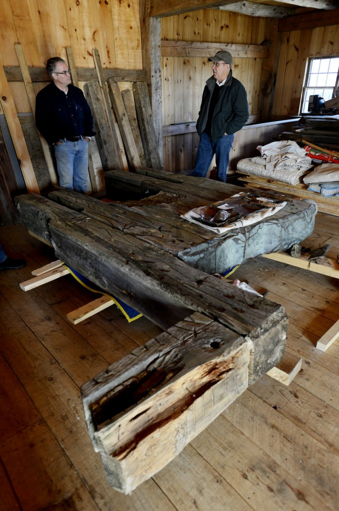 Arron Sturgis of Preservation Timber Framing in Berwick, with preservationist Jessica MilNeil, is working with the Ogunquit Museum of American Art to conserve a Bernard Langlais sculpture of a horse.