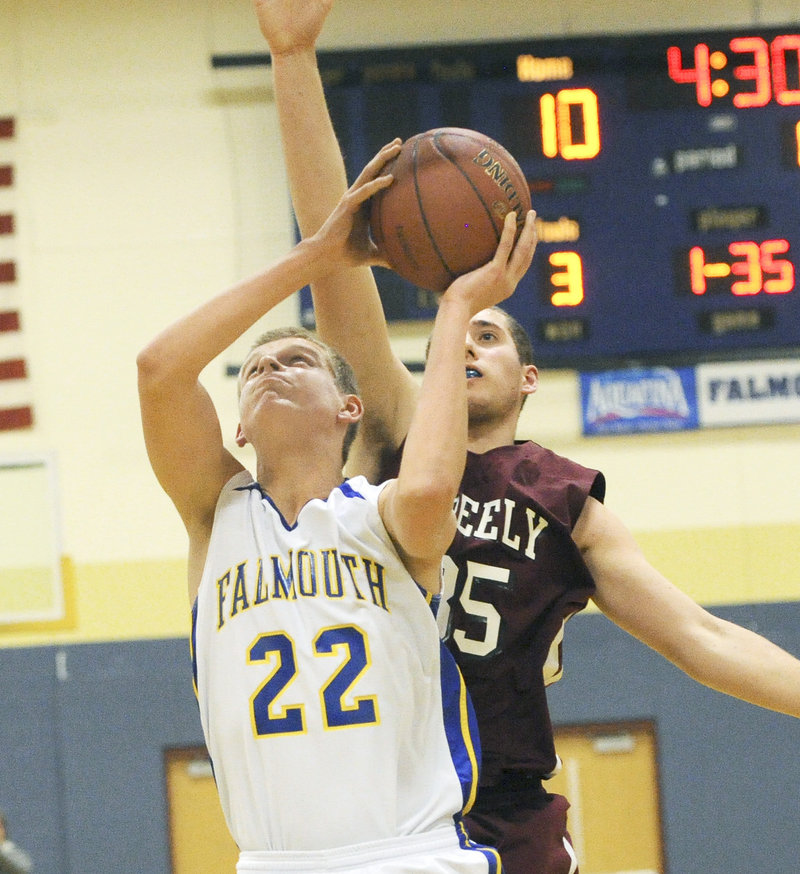 Jack Simonds of Falmouth prepares to shoot as Michael McDevitt of Greely approaches.