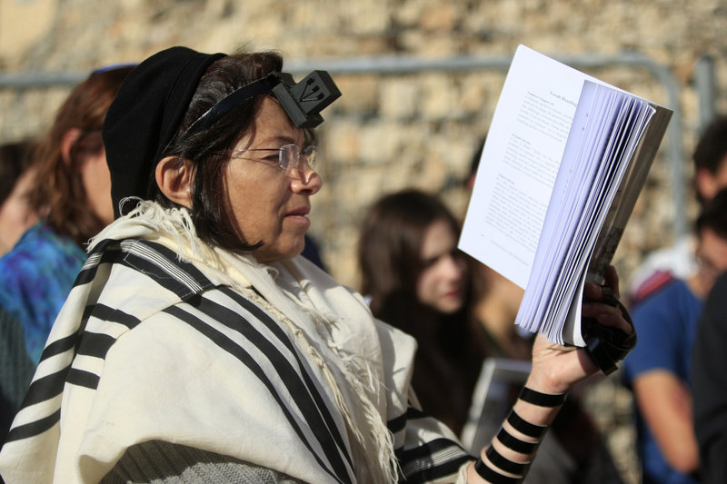 Israeli women members of the Women of the Wall don the trappings of men as they pray just outside the Western Wall, a holy site in Jerusalem's old city.
