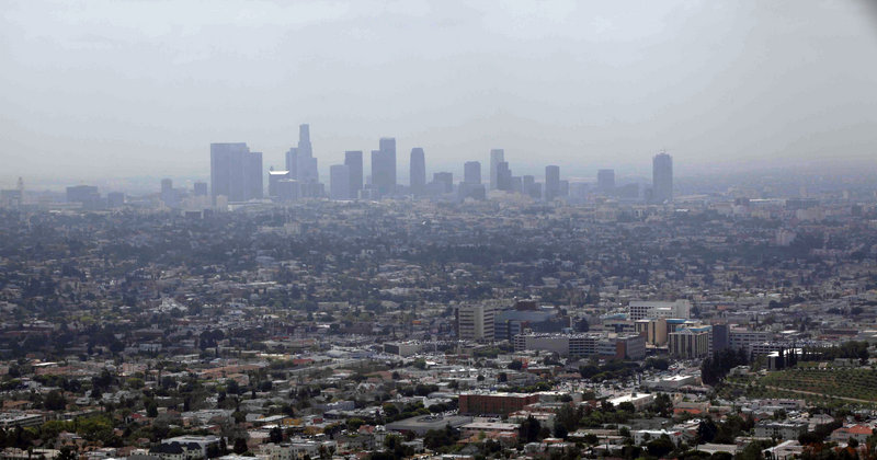 Downtown Los Angeles is covered in smog in this 2009 photo. For the first time in its 15-year history, the soot standard was cut, Friday, by the EPA. While many states are already in compliance, some, like California, have a long way to go.