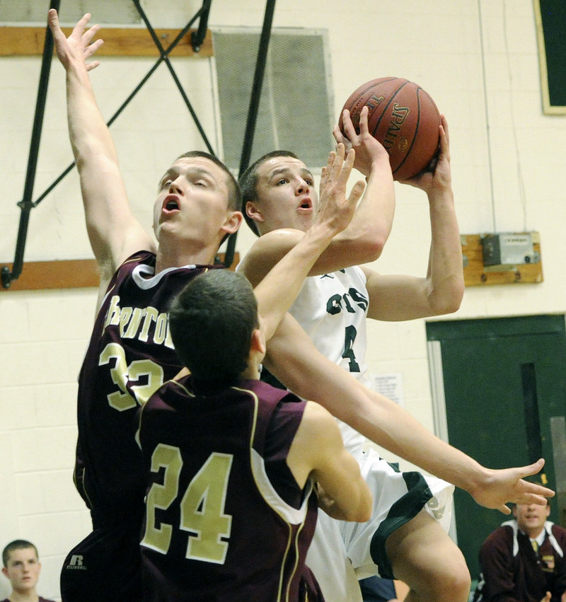 Dustin Cole of Bonny Eagle has Quinn Richard-Newton of Thornton Academy facing in the other direction while taking a shot in a 62-29 victory Friday night.