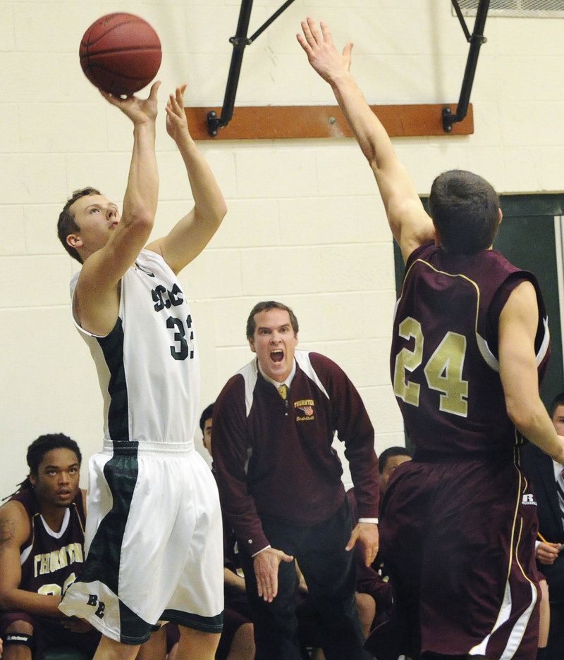 C.J. Autry of Bonny Eagle finds room to shoot over Reuben Moses of Thornton Academy during Bonny Eagle's 62-29 victory Friday night. Autry hit five 3-pointers and finished with 22 points.