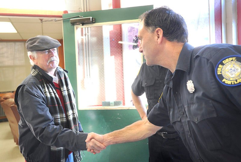 Robert Nannay of Old Orchard Beach shakes hands with Portland Firefighter Ralph Munroe as he visits the members of Ladder Company No. 3 on Stevens Avenue on Saturday. He thanked them for saving his life last October, using new protocols.