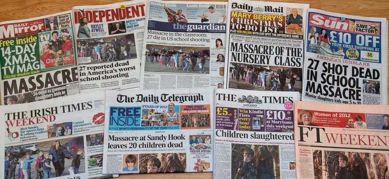 A photo of a selection of British and Irish newspapers for Saturday shows their front-page headlines and reaction to the school shooting in Newtown, Conn., on Friday.