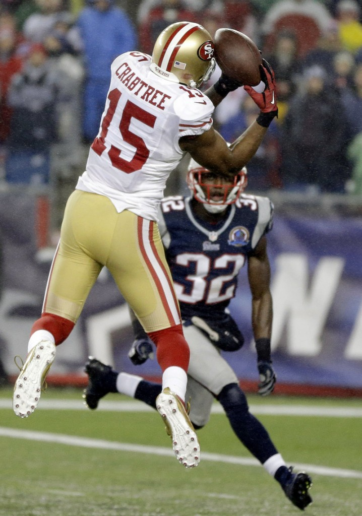 Michael Crabtree makes a catch against Devin McCourty and scores a touchdown in the third quarter. Crabtree later caught the winning TD pass in the fourth quarter.