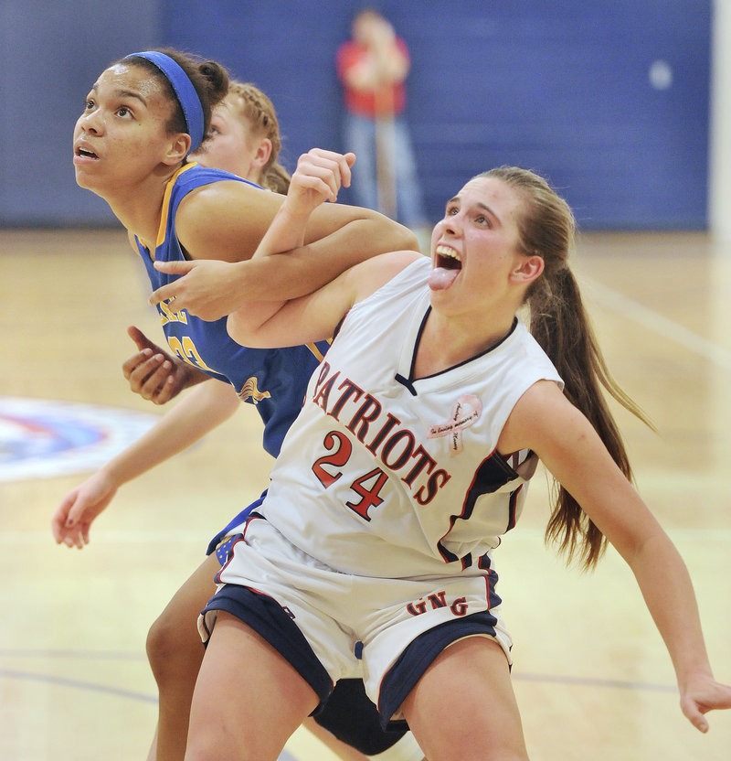 Maria Valente, right, of Gray-New Gloucester tries to fend off Lake Region's Tiana-Jo Carter for a rebound. Valente had 20 points for the Patriots.
