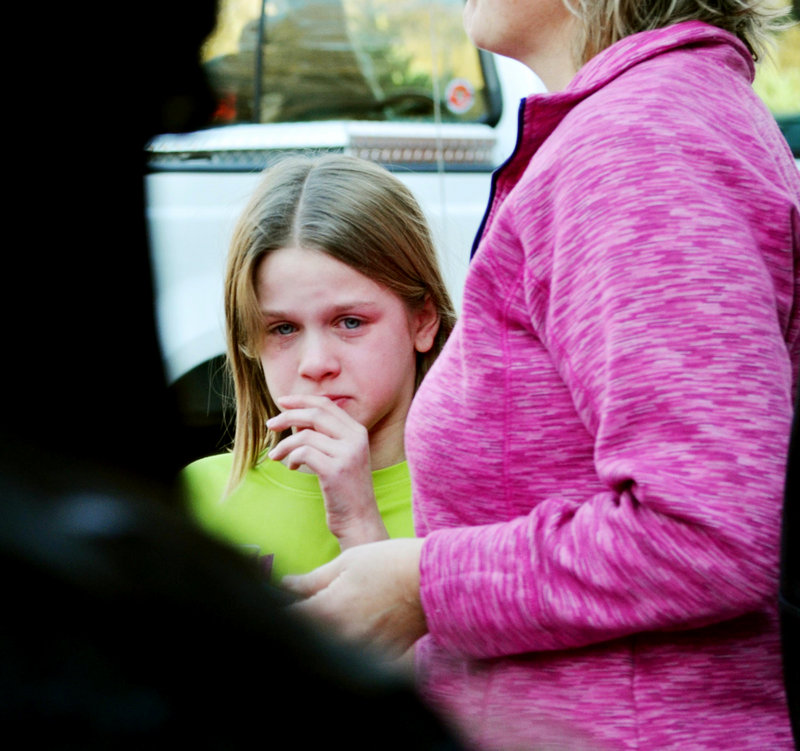 A young girl cries following the shooting Friday at the Sandy Hook Elementary School in Newtown, Conn. Experts say most of the young survivors of the massacre will get over it with no lingering effects. Some, however, may show signs of anxiety, depression or PTSD.
