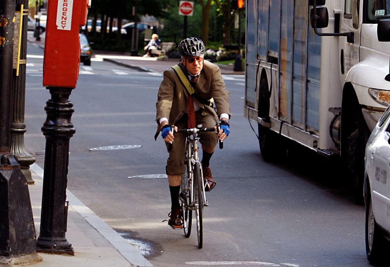 A cyclist commutes to work in Boston in 2008. A North Yarmouth man who rides his bike to work in Portland voices his appreciation for improvements to a stretch of road he rides and for the courtesy shown by road crews along the way.