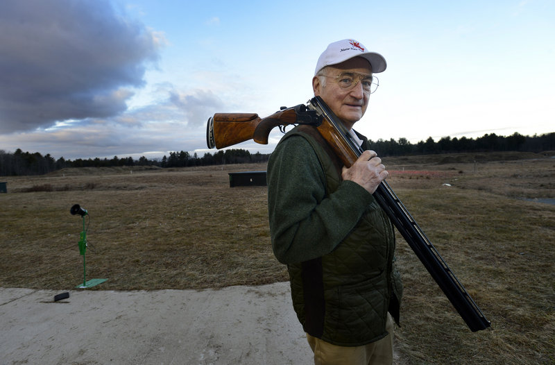Fred Wiegleb, president of the 1,000-member Scarborough Fish and Game Association, carries his Beretta DT10 shotgun at the firing range Thursday. Wiegleb said he never sees semi-automatic assault-style firearms at the club.