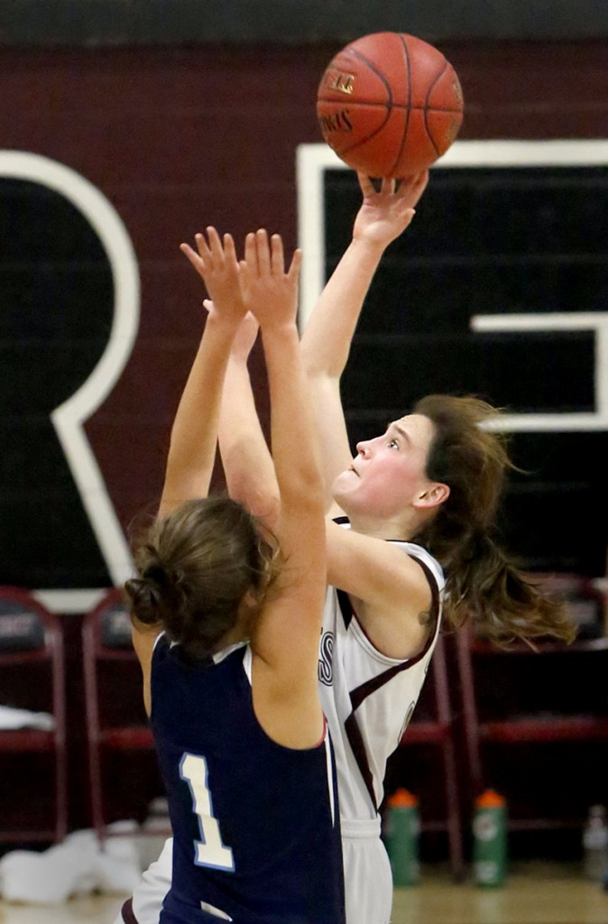 Aubrey Pennell of Freeport shoots over York's Ruby Cribby. Pennell scored 11 points, while Cribby was one of four players in double figures for York, finishing with 10 points.