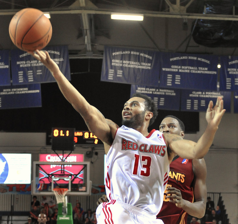 Maine's Xavier Silas drives in for a layup at the end of the first half during the Red Claws' 109-99 win over the Fort Wayne Mad Ants at the Portland Expo on Friday night. Silas finished with 19 points for Maine, which improved to 7-3.