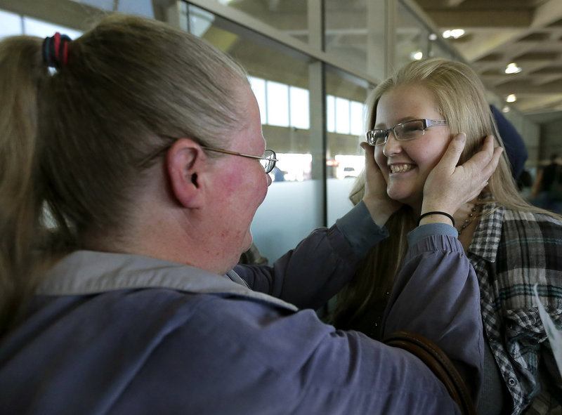 Diana Jones, left, takes a look at her daughter Sarah, 17, who weighed 74 pounds less after a four-month stay at a weight-loss boarding school. She attended with 13 students from the Independence, Mo., school district.