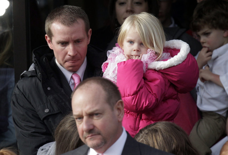 Robbie Parker, left, carries his daughter Madeline, 4, after the funeral Saturday at a Mormon church in Ogden, Utah, for his 6-year-old daughter, Emilie, a victim of the Newtown, Conn., shooting. The Parker family has roots in Ogden.