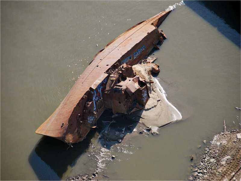 A World War II minesweeper is exposed in its Mississippi River grave. Once moored as a museum at St. Louis, it was torn away by floods two decades ago. Now it – and hundreds of other sunken boats – are visible once again thanks to water levels lowered by a lack of rain.