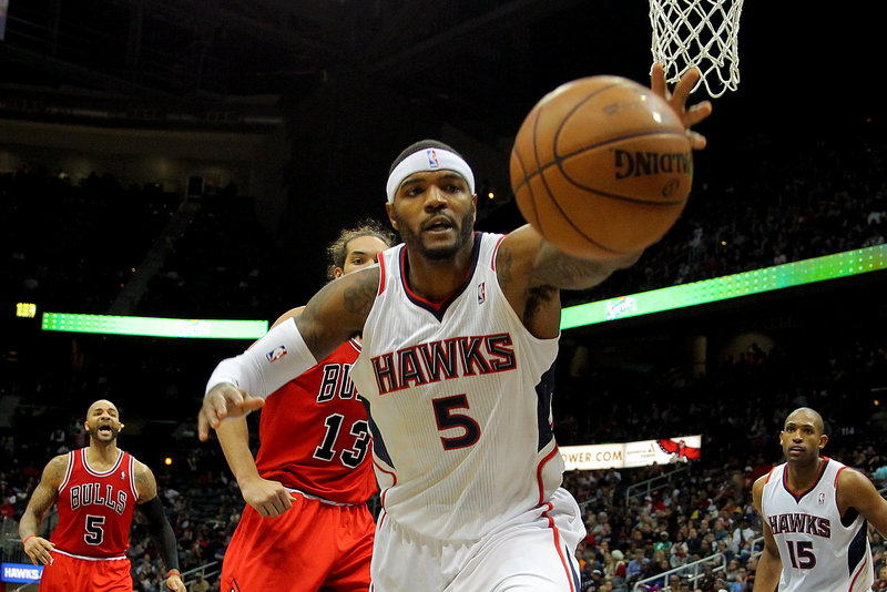 Josh Smith, small forward for Atlanta, reaches for a rebound during second-half action of the Hawks' 92-75 victory over the Chicago Bulls Saturday night.