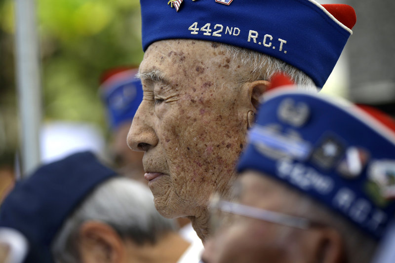 Veterans from the 442nd Regiment, of which Sen. Daniel Inouye was a part, listen at Inouye's memorial service Sunday in Honolulu.