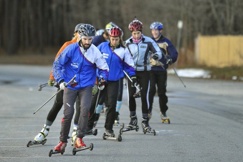 Aaron Duphily, a Cheverus High teacher, leads the group of high school skiers known as Portland Nordic at the start of a training session. There was bare pavement that day, but good skiing is on the way.