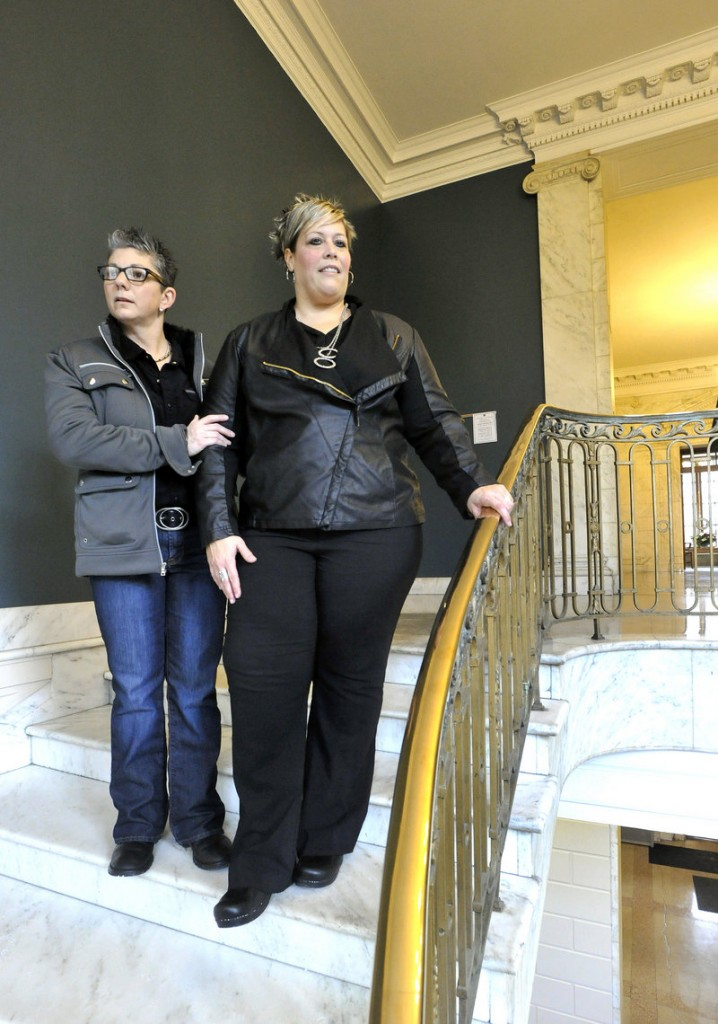 Donna Galluzzo, 49, left, and Lisa Gorney, 45, who have been together for three years, visit Portland City Hall on Wednesday ahead of their weekend wedding to select a spot for the ceremony, settling on the building's interior curving marble staircase.
