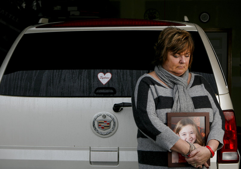 Judy Neiman of West Richland, Wash., holds a photo of her daughter, Sydnee, who she killed in 2011 while backing up her vehicle in a bank parking lot. Nieman is pleading for the government to implement rear-view safety measures that were ordered in 2008.