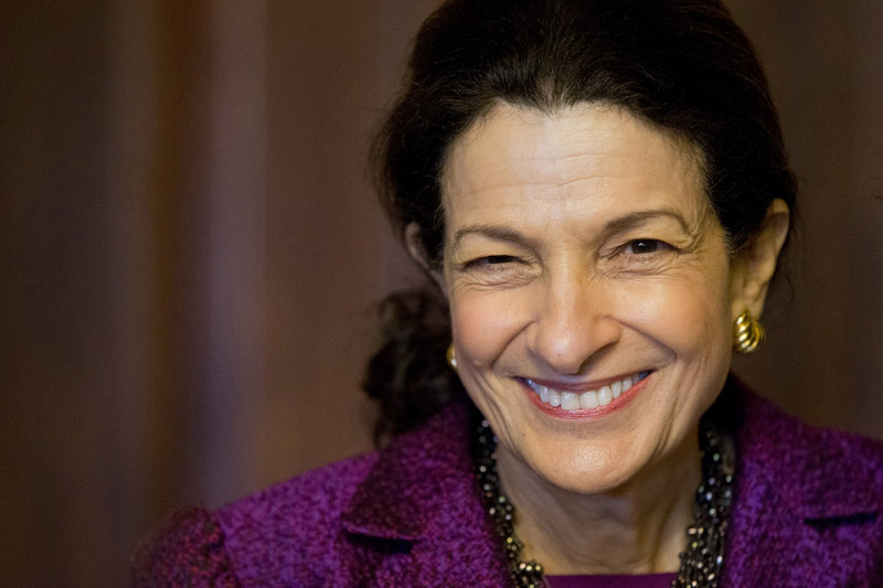 Sen. Olympia Snowe, named by Time magazine as one of 100 most influential people in the world in 2010, smiles after delivering her farewell speech to the Senate.