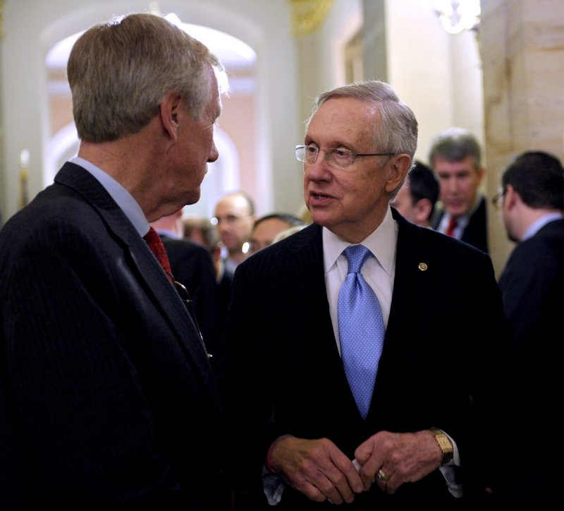 Senate Majority Leader Harry Reid of Nevada talks with Sen.-elect Angus King on Capitol Hill last month after King announced he will caucus with Democrats, adding to the party's voting edge. King says he will remain independent.