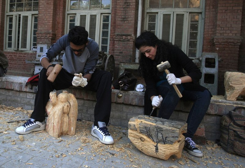 Pakistani students carve statues Dec. 6 at the National College of Arts in Lahore. A series of provocative paintings of Muslim clerics in scenes suggesting homosexuality has sparked an uproar and threats of violence by Islamic extremists. Space for progressive thought is shrinking in Pakistan as hard-line interpretations of Islam gain ground.
