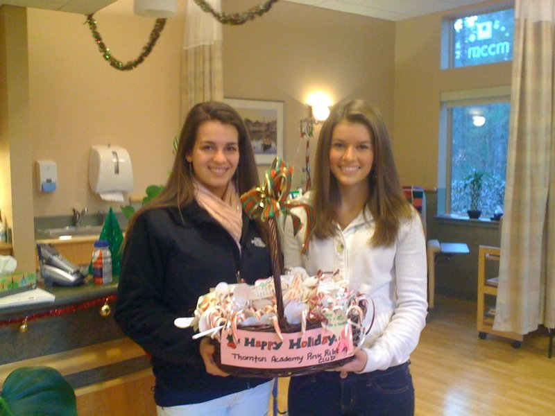 Thornton Academy seniors Sydney Kelly, left, and Delaney Seavey recently visited the Cancer Care Center of York County in Sanford to deliver some sweet holiday cheer just before the Christmas holiday. The girls came as representatives of the school's Pink Ribbon Club.