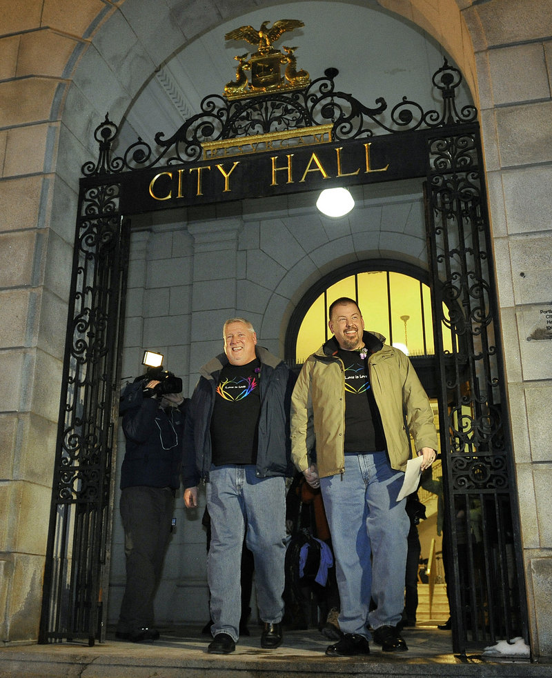 "The first to wed: Michael Snell, left, and Steven Bridges leave Portland City Hall early Saturday after becoming the first gay couple to be married in Maine. The mayor said theirs ""may be the most covered marriage"" in the state's history."