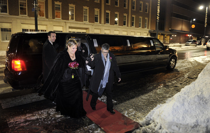 Lisa Gorney and Donna Galluzzo, both of Portland, arrive in style – complete with red carpet – at Portland City Hall late Friday night, shortly before the 12:01 a.m. moment Saturday when same-sex marriage would become legal in Maine. Supporters gathered outside cheered their arrival.