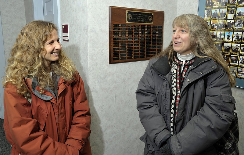 Together for 23 years, Laura Minervino, left, and Robin Elliott obtain their marriage license at South Portland City Hall on Saturday. They plan to wed next month.