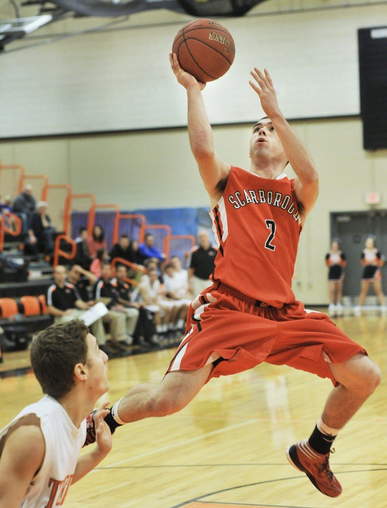 Dillon Russo of Scarborough puts up a shot Saturday at the end of a fast break during the Red Storm's 60-50 victory against Biddeford.