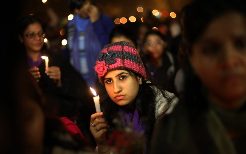 The Associated Press Indians take part in a vigil Saturday in New Delhi to mourn the death of a gang-rape victim. Six men have been charged with murder, adding to accusations that they beat and raped the woman.