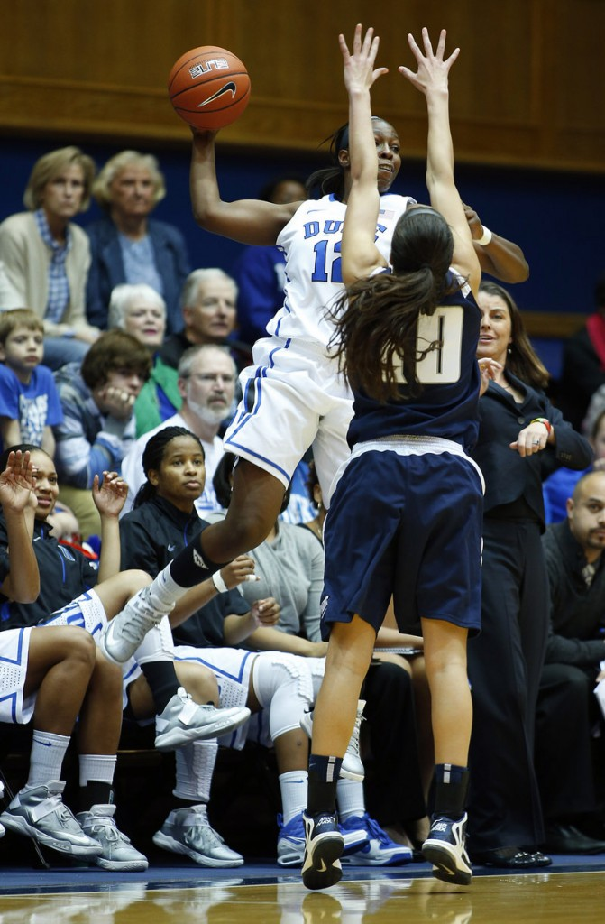 Duke's Chelsea Gray makes a leaping attempt to pass against Monmouth's Chevannah Paalvast during the Blue Devils' 73-32 win at Durham, N.C., on Sunday.