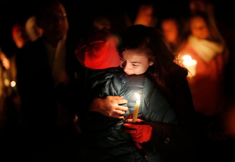 Maria McKeown of Biddeford embraces her aunt Carol LaMontagne of Biddeford at the vigil.