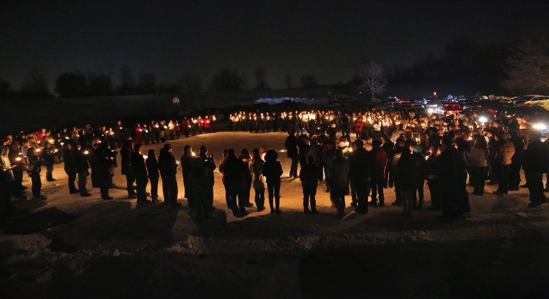 Hundreds attend a vigil at Rotary Park in Biddeford on New Year's Eve to remember Derek Thompson, 19, and his girlfriend Alivia Welch, 18, whow ere shot and killed by their landlord James Pak on Saturday.