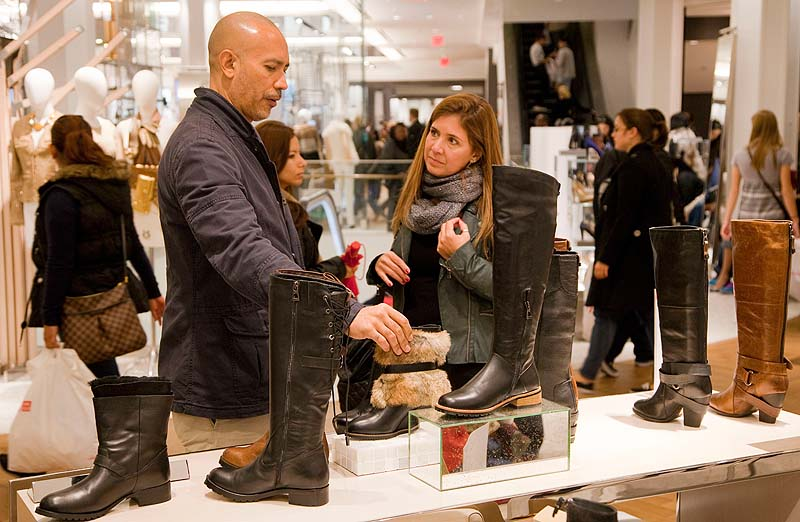 Customers shop for Rudsak shoes at Macy's shoe department in New York. Shoes are a top seller this holiday season.