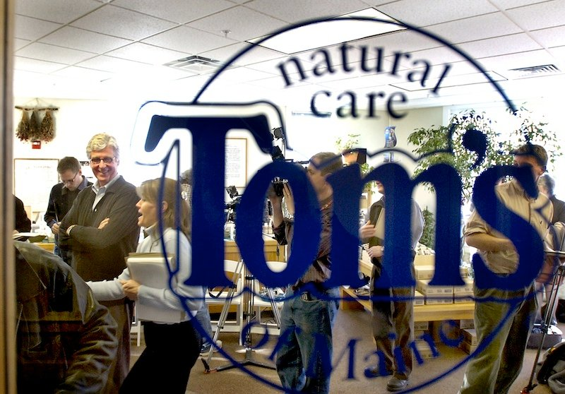 In this March 2006 file photo, Tom Chappell is seen through his store window for Tom's of Maine outlet in Kennebunk. The widely known Kennebunk-based producer of all-natural personal care products, has moved its research and development department to its parent company in New Jersey.