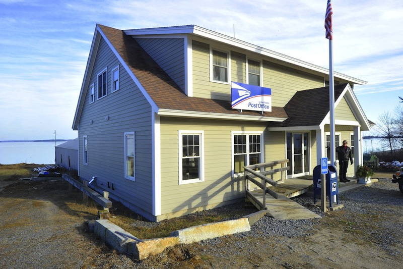 In this Dec. 13, 2012 file photo, the Chebeague Island Post Office. The US Postal Service was proposing a reduction in island business hours despite widespread opposition from year-round residents, but island post offices in Maine will now stay open at least six hours a day.