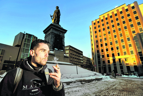 Jason Lemay, 26, of Portland, smokes a cigarette in Monument Square late Monday afternoon. Lemay says he is opposed to a proposed smoking ban in Monument Square and many other public spaces.