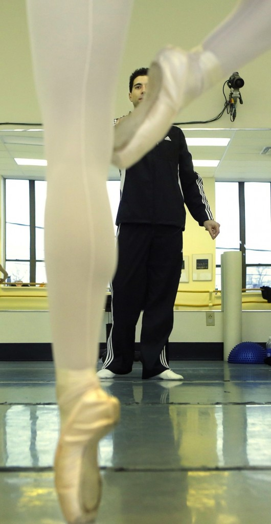 Instructor Joseph Morrissey watches a dancer work through a routine during dance practice at Portland Ballet. Morrissey began dancing with the Boston Ballet at age 18 and has worked with dance companies across the U.S. and overseas.