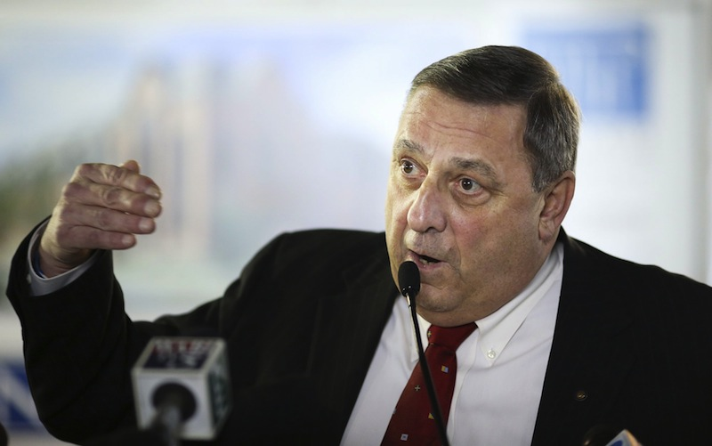Gov. Paul LePage gestures during a press conference at the University of New England's College of Dental Medicine Patient Care Center Building, Tuesday, January 15, 2013. A municipal group estimates all of his new budget initiatives would cost towns and cities $420 million.