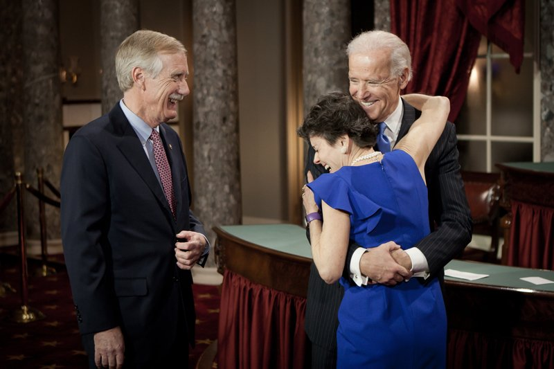 "Shortly after he was sworn in Thursday, Sen. Angus King, a Maine independent, laughs along with his wife, Mary Herman, and Vice President Joe Biden as they embrace on the floor of the Old Senate Chamber in the U.S. Capitol. The new senator thanked the current batch of leaders ""for not solving all of the problems, for saving some."""