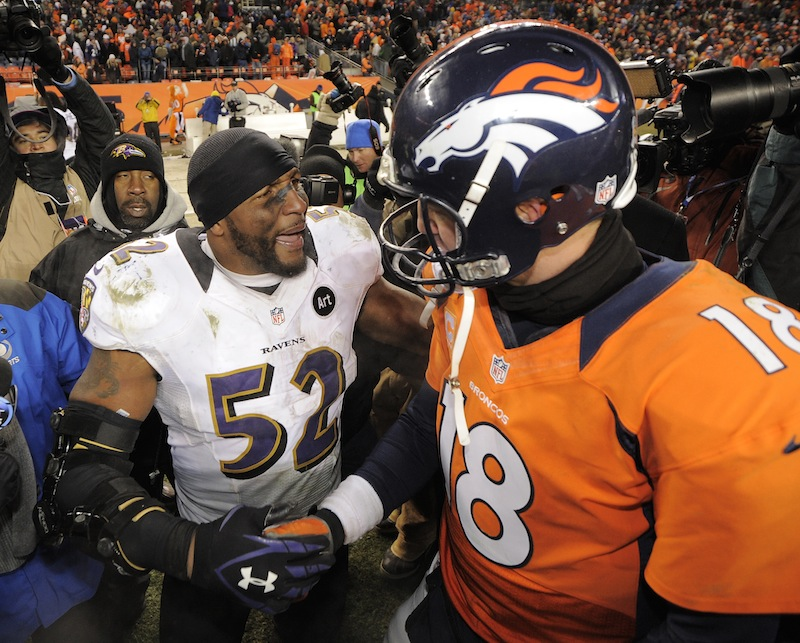 Baltimore Ravens inside linebacker Ray Lewis shakes hands Denver Broncos quarterback Peyton Manning (18) after the Ravens won 38-35 in overtime of an AFC divisional playoff NFL football game, Saturday, Jan. 12, 2013, in Denver. (AP Photo/Jack Dempsey) Sports Authority Field at Mile High Stadium