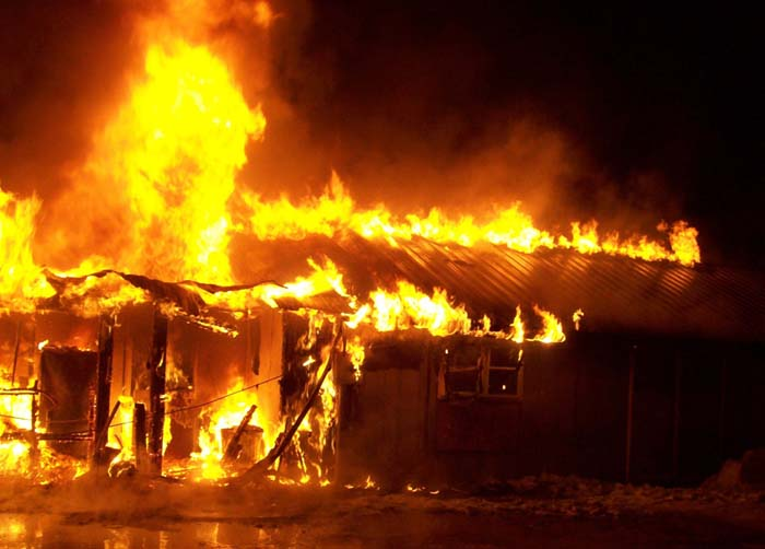 Fire consumes a house and attached garage at 17 Sandville Road in Limington on Friday.